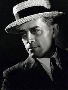 Photo of W. S. Van Dyke wearing a hat