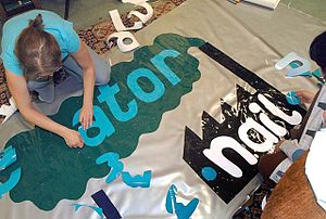 Banner-making - Nottingham based arts activist collective The Mischief Makers make banners using reclaimed sticky back plastics