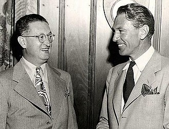 """Showmen's Trade Review - Showmen's Trade Review editor and publisher Charles E. """"Chick"""" Lewis with actor Gary Cooper, Hollywood, California, August 30, 1944"""