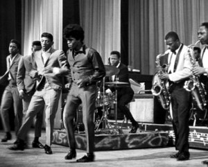 James Brown - Brown (middle) and The Famous Flames (far left to right, Bobby Bennett, Lloyd Stallworth, and Bobby Byrd), performing live at the Apollo Theater in New York City, 1964