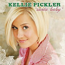 "A headshot of American singer Kellie Pickler appears, wearing a striped, red and white shirt. The words ""Kellie Pickler"" and ""Santa Baby"" are above her, in a green and red font, respectively."