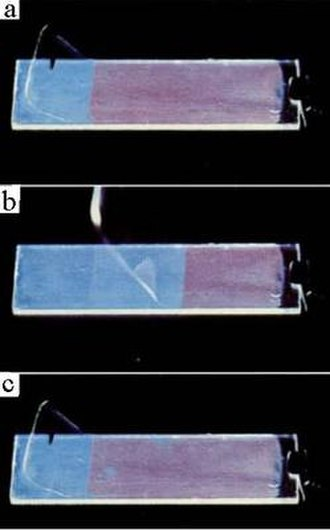 Hans Kuhn - Separating and contacting (from a to b and from b to c) in atomic precision. Monolayer of a blue fluorescent dye (donor) on a glass slide partially covered by a monolayer of a red fluorescent dye (acceptor) fixed at a PVA-polymer layer. Energy transfer from donor to acceptor at contact. Courtesy Dietmar Möbius. Reproduced with permission, Wiley-VCH Verlag