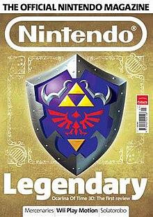 capa da revista apresenta uma imagem de um escudo Hylian de The Legend of Zelda eo texto 'Legendary - Ocarina of Time 3D: A primeira revisão'.