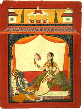 Women in India - Krishna at Goddess Radharani's feet.