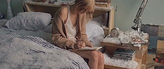 Back to December - Swift writing a letter to her ex-boyfriend in a room filled with snow.