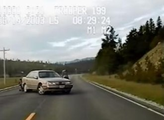 2003 Ennis shooting - Footage of the shootout between Davis and officer Hildenstab. Davis is positioned behind the rear bumper of his sedan, aiming at Hildenstab.