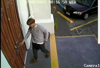 Charleston church shooting - Dylann Roof entering Emanuel African Methodist Episcopal Church through a side door at 8:16 pm, as captured on CCTV