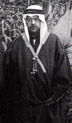 Izzat Darwaza - Darwaza in traditional Arab robe