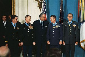 Drew Dennis Dix - Dix (far right) and three other men shortly after receiving their Medals of Honor from President Lyndon B. Johnson (center).