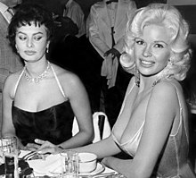 Sophia Loren and Jayne Mansfield, seated at a restaurant table