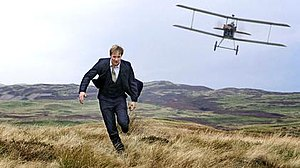 "The 39 Steps (2008 film) - Hannay (Penry-Jones) being chased by a 1916 biplane in a promotional image from the production. Penry-Jones was ""delighted"" that the scene was included, but it drew criticism and viewer complaints for its historical inaccuracy."