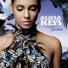 "A young woman with her eyes closed, wearing a feathered dress that covers her chest, bares her shoulders and goes around her neck. Laid against a blue background, a white dove is seen flying behind her to the left. The name ""Alicia Keys"" is written to the right in white font and ""The Element of Freedom"" is written below that in dark blue font."