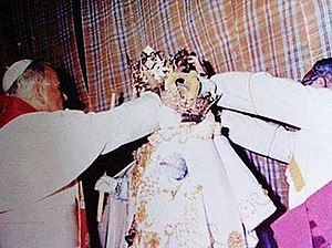 Our Lady of the Candles - Pope St. John Paul II crowning the image of Nuestra Señora de la Candelaria at the facade of Jaro Cathedral, on 21 February 1981.