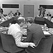 Pierre Trudeau and Jean Chrétien conferring, photographed from behind