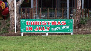 Christmas in July promotional banner outside a...