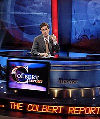 Colbert on the set of The Colbert Report. Note the three instances of the show's title.