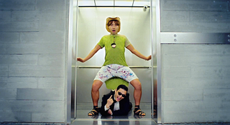 "Gangnam Style (music video) - Psy (below) and Noh Hong-chul (above) in the elevator scene in the music video of ""Gangnam Style""."