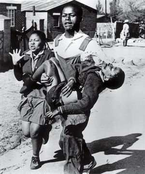 Soweto uprising - Hector Pieterson being carried by Mbuyisa Makhubo after being shot by South African police. His sister, Antoinette Sithole, runs beside them. Pieterson was rushed to a local clinic and declared dead on arrival. This photo by Sam Nzima became an icon of the Soweto uprising.