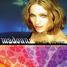 Madonna looking towards the camera in front of a blue background. The lower half of the cover art shows the artist and song name in front of a violet flowery background.