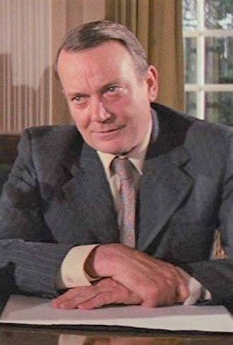 Denholm Elliott - Elliott as Marcus Brody in  Raiders of the Lost Ark (1981)