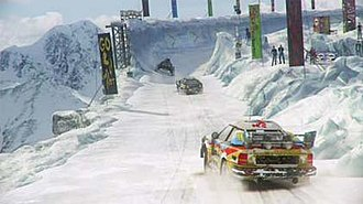 MotorStorm: Arctic Edge - A still from one of the MotorStorm: Arctic Edge trailers showing a Wulff Bolter rally car, one of the driveable rally cars in the game.