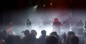 New Model Army (band) - New Model Army at The Forum, London on 11 December 2015 (left to right) Marshall Gill, Justin Sullivan, Ceri Monger, Dean White