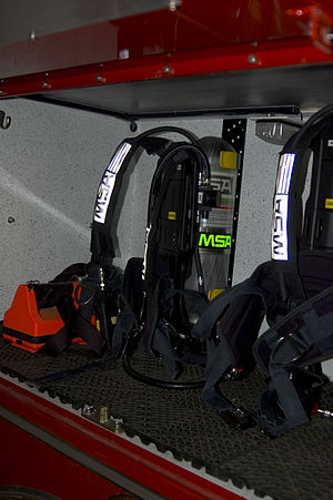 Self-contained breathing apparatus - SCBA packs carried on a rack in a firetruck