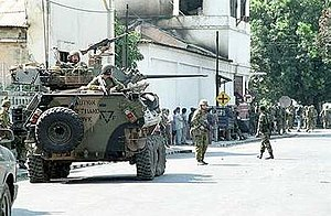 2nd Cavalry Regiment (Australia) - An ASLAV from 2nd Cavalry Regiment with Australian soldiers in East Timor in 1999.