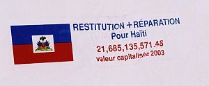 External debt of Haiti - Sticker in Port-au-Prince demanding repayment from the French government