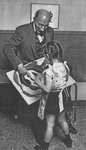 William E. Blatz - Dr. Blatz with a young child, 1961