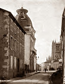 19th-century provincial French street scene with smart buildings