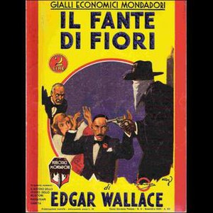 Giallo - Mondadori's 1933 translation of Edgar Wallace's 1920 novel Jack O' Judgement (rendered in Italian as Il Fante di Fiori, The Jack of Clubs), with the characteristic yellow background and the figure of a masked killer