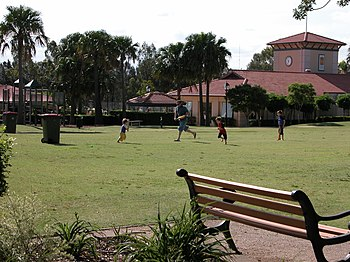 A family playing cricket on the Village Green