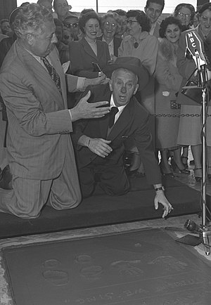 Ezio Pinza - Ezio Pinza (left) jokes with comedian Jimmy Durante as Pinza leaves his imprints at Grauman's Chinese Theater in Los Angeles, 1953.