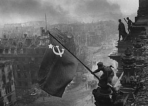 Soviet soldiers raising the Soviet flag over t...