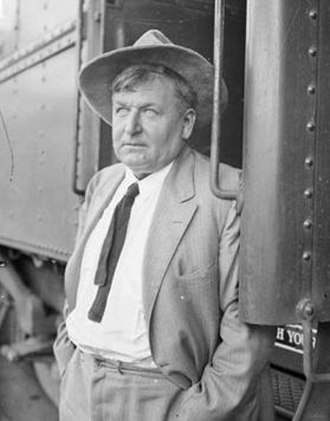 "Walter E. Scott - Walter Scott, aka ""Death Valley Scotty"" and a train in Chicago in 1926. Photo from the Chicago Daily News negatives collection, DN-0003451. Courtesy of the Chicago Historical Society."