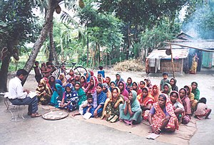Solidarity lending - Solidarity lending involves collateral-free loans through solidarity groups and village organizations like this one in Bangladesh. Photo by Brett Matthews.