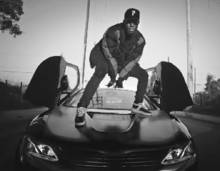 f97bd208 Tiller standing on a BMW i8 in the music video for