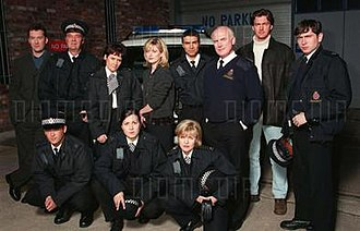 City Central (TV series) - The cast of the first series (from L-R): Ian Burfield, Paul Nicholls, Dave Hill, Lorraine Ashbourne, Sarah Kirkman, Kate Gartside, Ian Aspinall, Ashley Jensen, Terence Harvey, Ray Stevenson and Stephen Lord