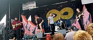 Dance Gavin Dance performing at the Minneapolis, MN date of Warped Tour 2017.jpg