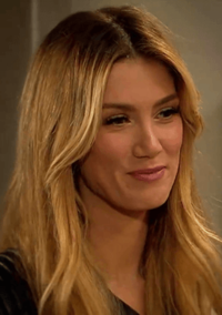 Delta Goodrem as Nina Tucker (2015).png