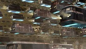 Millions of flying cars are held in gridlock on a futuristic motorway filled with car fumes.