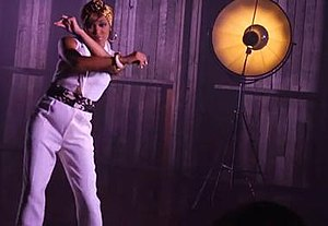 Anything (To Find You) - One of the fashionable light-tinged scenes from the video, where Monica sings dancing.