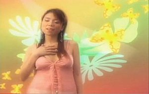 I'll Always Love You (Michael Johnson song) - Nina singing on the music video, while a colorful animated background is seen moving behind her.