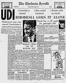 "The front page of a newspaper, ""The Rhodesia Herald"". The main headline is ""UDI—Rhodesia goes it alone""."
