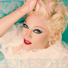 "Upside down image of Madonna laid down in a bed, wearing heavy makeup with her hand to her head, with ""Madonna"" written in pink capital lettters, while ""Bedtime Stories"" is written in sky-blue capital letters."