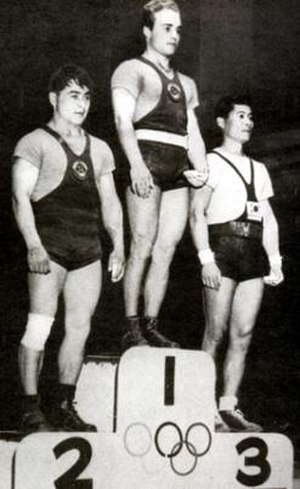 Ihor Rybak - Rybak (center) at the 1956 Olympics