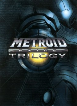 "In the background, a person in a big, futuristic-looking powered suit with a helmet, large, bulky, and rounded shoulders, points its firearm on the right arm towards the viewer. In the center of the image is the title ""Metroid Prime Trilogy"". At the upper right corner is the Wii logo, and in the bottom of the image, are the words ""Collector's Edition"" in an orange rectangle, Nintendo's logo, and ESRB's rating of ""T""."