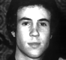 A black and white photo of a young white man's head, slightly overexposed