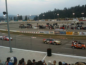2012 NASCAR Canadian Tire Series - The Canadian Tire Series leaders following the pace car at Motoplex Speedway in July 2012.